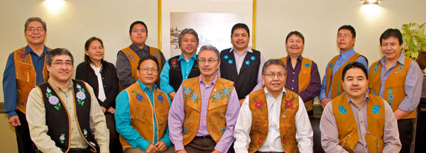 Back row from left to right Assembly Members - Noel Bishop, Rosa Mantla, Robin Laboline, Joseph Judas, George Nitsiza, Sonny Zoe, Garry Bekale, Henry Gon. Front row from left to right - Chief Clifford Daniels,  Chief Johnny Arrowmaker, Grand Chief Eddie Erasmus, Chief Alfonz Nitsiza & Chief David Wedawin
