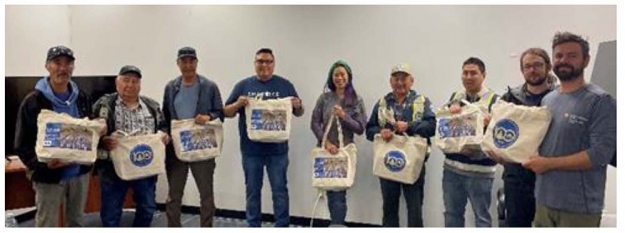 Imaryuk and Munaqaiyit monitors, DFO staff and Joint Secretariat staff with their gift bags from Tłı̨chǫ Government